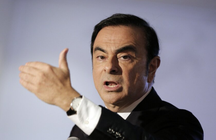 Chairman and CEO of Renault-Nissan Carlos Ghosn addresses reporters during a press conference in Boulogne Billancourt, outside Paris Friday, Feb. 12, 2016. French car maker Renault says higher sales and further progress on its industrial turnaround plan helped drive a nearly 1 billion euro increase
