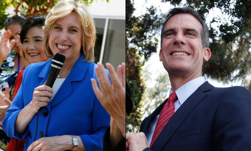 Los Angeles mayoral candidates Wendy Greuel and Eric Garcetti spent the weekend furiously courting voters across the city.