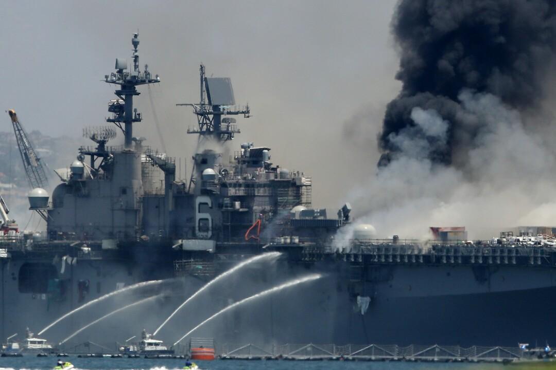 A fire burns on the amphibious assault ship USS Bonhomme Richard