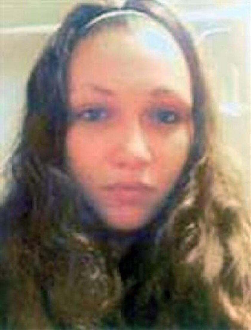 This undated image provided by the FBI shows Ashley Summers. Summers disappeared in 2007 near the house where three missing women were found on Monday, May 6, 2013, near downtown Cleveland. The FBI did not immediately return a call about the case and whether it was connected to that of the three mi