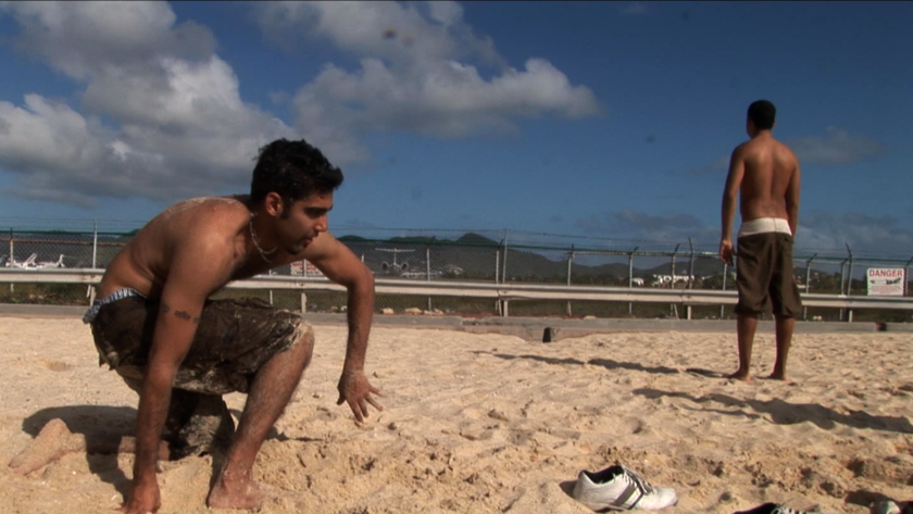 """Jason DaSilva on the beach with family in a scene from """"When I Walk."""""""