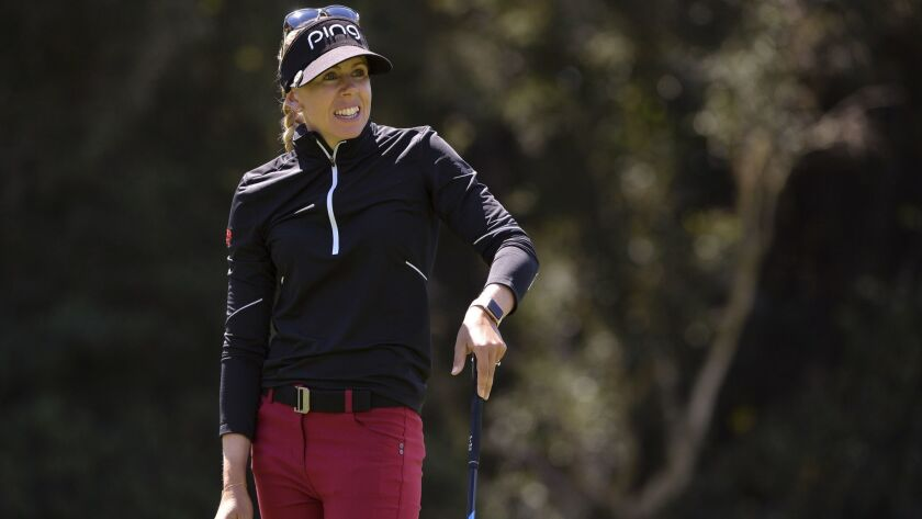 Pernilla Lindberg of Sweden watches her shot from the second tee during the first round of the Kia C