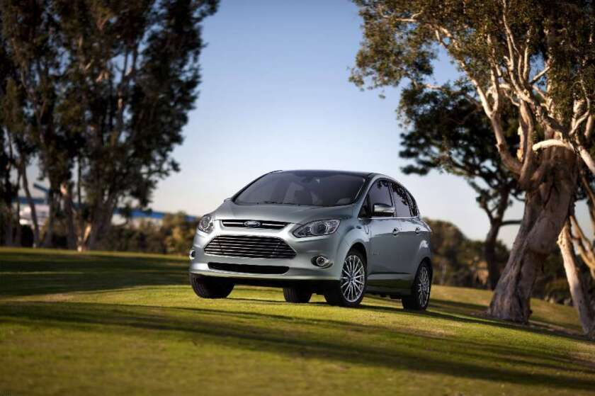 The Ford C-MAX Energi plug-in hybrid. Honda and Ford are expanding their green-car offerings to U.S. consumers.