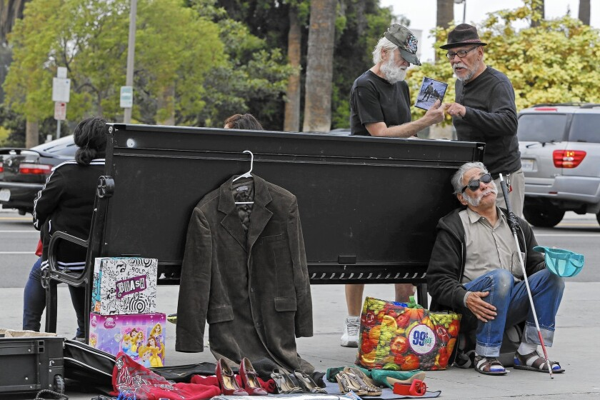 Street vendors like these on Alvarado Street in Los Angeles complain that police aren't issuing receipts for property seized as evidence.