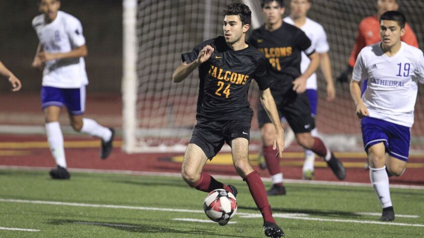Torrey Pines' Alec Philibbosian dribbles the ball in front of Cathedral's goal during the Southern C