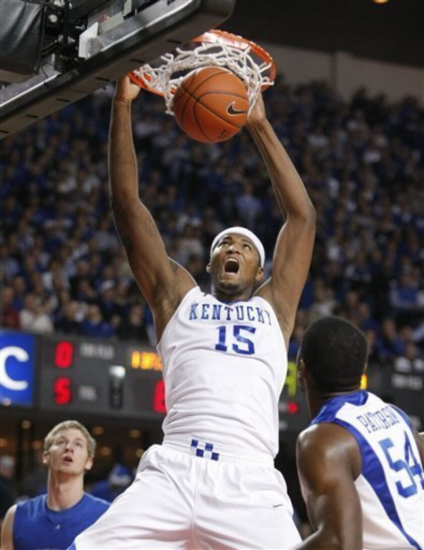 Kentucky's DeMarcus Cousins dunks during the first half of an NCAA college basketball game against North Carolina-Asheville in Louisville, Ky., Monday, Nov. 30, 2009. (AP Photo/Ed Reinke)