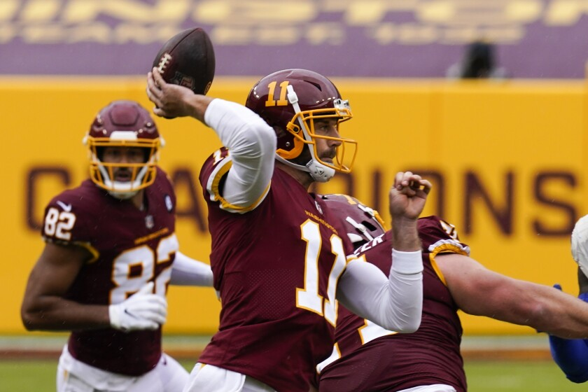 Washington quarterback Alex Smith throws during the first half of Sunday's loss to the Rams.