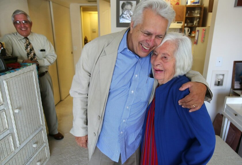 Amparo Ketcham, who turns 104 on Thursday, with her son Charles Ketcham, 72, center, and son Ed Ketcham, 70, at her San Marcos apartment Wednesday. photo by Bill Wechter