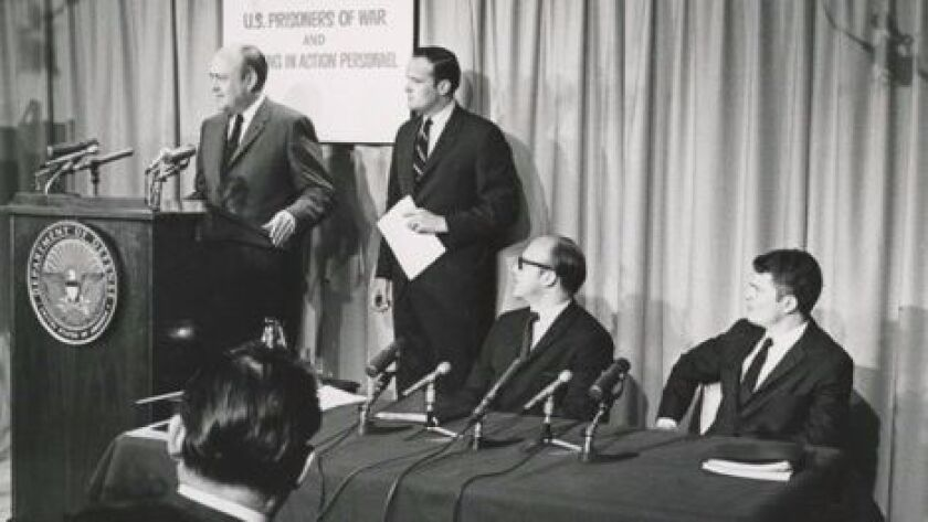 Secretary of Defense Melvin Laird gives the opening statement of a press conference on May 19, 1969 to publicize the plight of U.S. POWs and MIAs in North Vietnam. Standing to his right is his deputy, Richard Capen, who now lives in La Jolla.