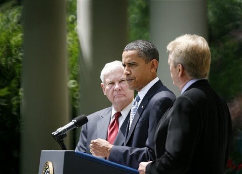 President Barack Obama, accompanied by BP Oil Spill Commission co-chairs, former Florida Sen. Bob Graham, and former EPA Administrator William Reilly, speaks in the Rose Garden of the White House in Washington, Tuesday, June 1, 2010. (AP Photo/Charles Dharapak)