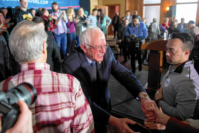 Bernie Sanders greets members of the crowd at a campaign event Tuesday in Carroll, Iowa.