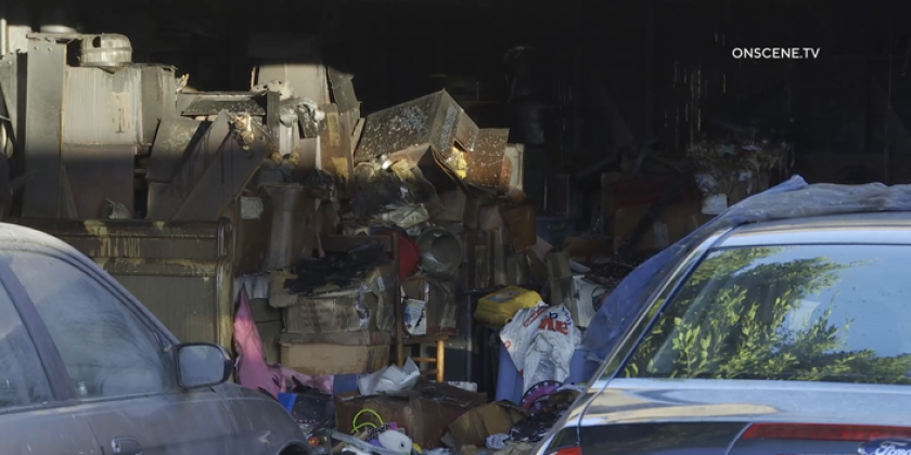 A fire in a Chula Vista home's garage that was cluttered with belongings displaced four residents early Sunday.