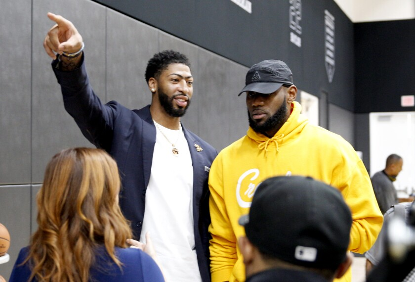 LeBron James and Anthony Davis chat during a Lakers-Pelicans game this spring at Staples Center.