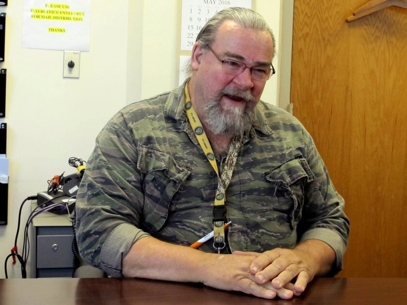 In this Monday, May 2, 2016 photo, Tom Alligood, a veteran and certified nursing assistant, speaks during an interview at the Dorn Veterans Administration Hospital in Columbia, S.C., Alligood knows all about the bad press suggesting the nation isn't properly caring for its veterans. The nurse assis