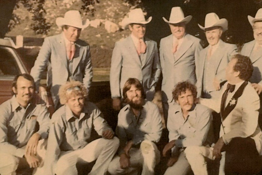 Black Canyon Blues Band original members, front row, performed with the Sons of the Pioneers Band, shown in cowboy hats, at rodeo performer Casey Tibbs' wedding. The ceremony was held in Ramona Oaks Park in 1979. Tibbs is shown in the front row at far right.