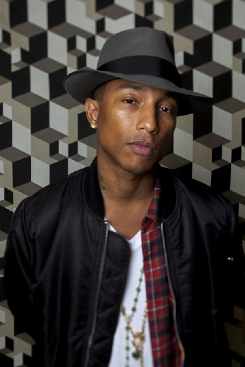 """Singer-songwriter and music producer Pharell Williams, who produced the song """"Happy"""" for the movie """"Despicable Me 2,"""" will perform the song at the Oscars next month."""