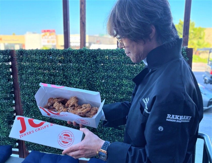 Junya Watanabe with his karaage chicken at  RakiRaki Ramen on Convoy Street in San Diego.
