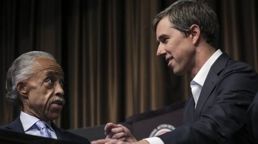 The Rev. Al Sharpton, left, speaks to former Rep. Beto O'Rourke at the National Action Network's annual convention in New York City. The meeting features speeches by many of the Democrats seeking the party's presidential nomination.