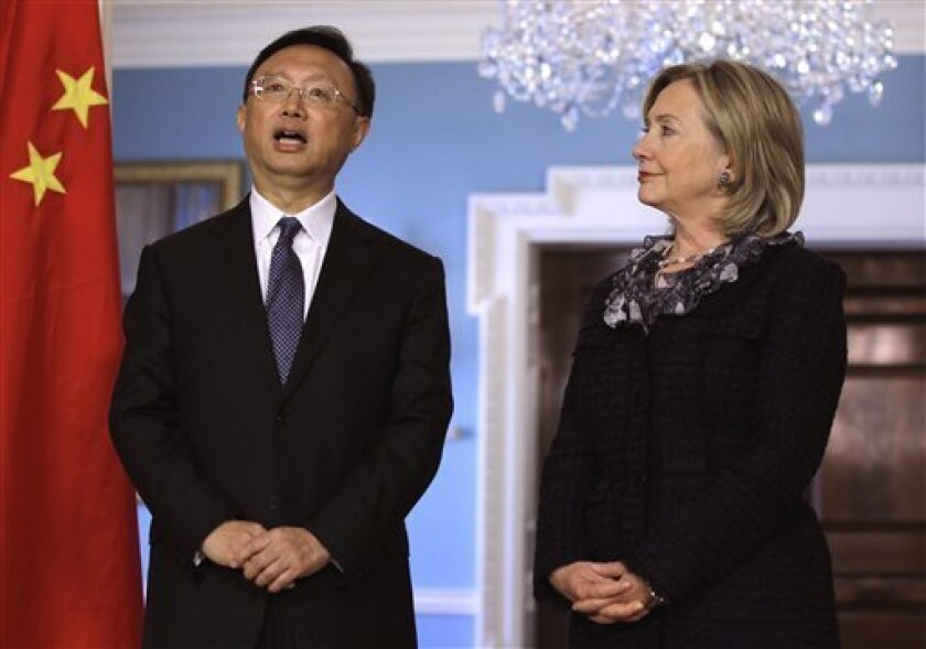 Chinese Foreign Minister Yang Jiechi, left, talks as Secretary of State Hillary Rodham Clinton looks on during a meeting at the State Department in Washington, Wednesday, Jan. 5, 2011. (AP Photo/Luis M. Alvarez)