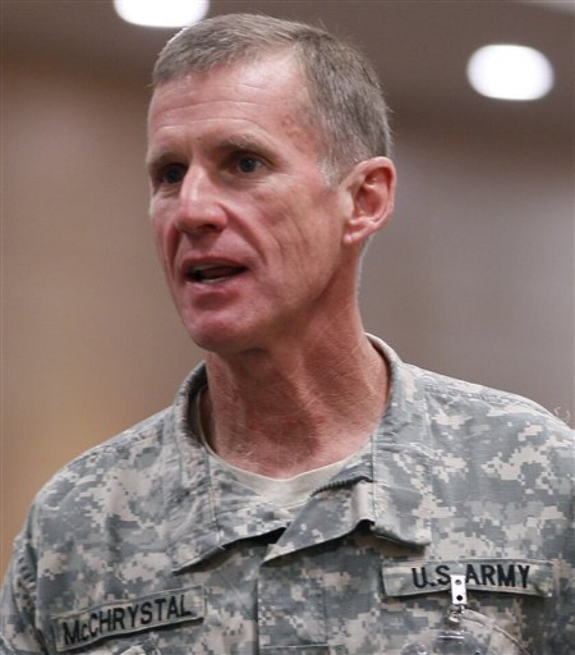 U.S. Gen. Stanley McChrystal, the commander of the NATO and U.S. forces in Afghanistan, pauses in the hall before attending a meeting with U.S. Defense Secretary Robert M. Gates, not pictured, at NATO headquarter in Brussels, Thursday, June 10, 2010. (AP Photo/Carolyn Kaster, Pool)