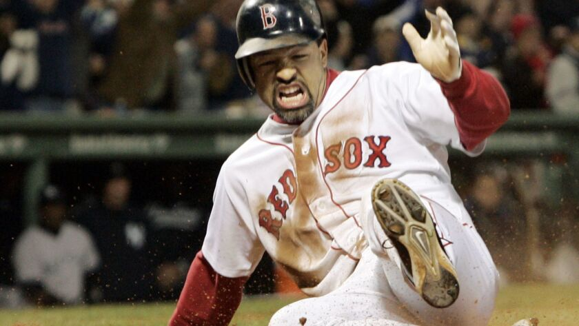 Boston Red Sox's Dave Roberts slides home to score the tying run against New York Yankees' Mariano R