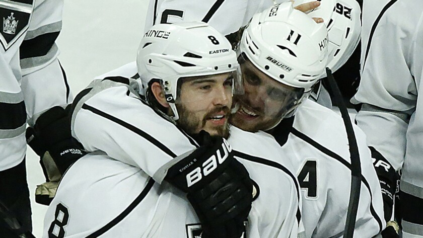 Kings center Anze Kopitar, right, hugs teammate Drew Doughty after the team's Game 7 win over the Chicago Blackhawks. Doughty is considered a favorite to be named the most valuable player of the playoffs.