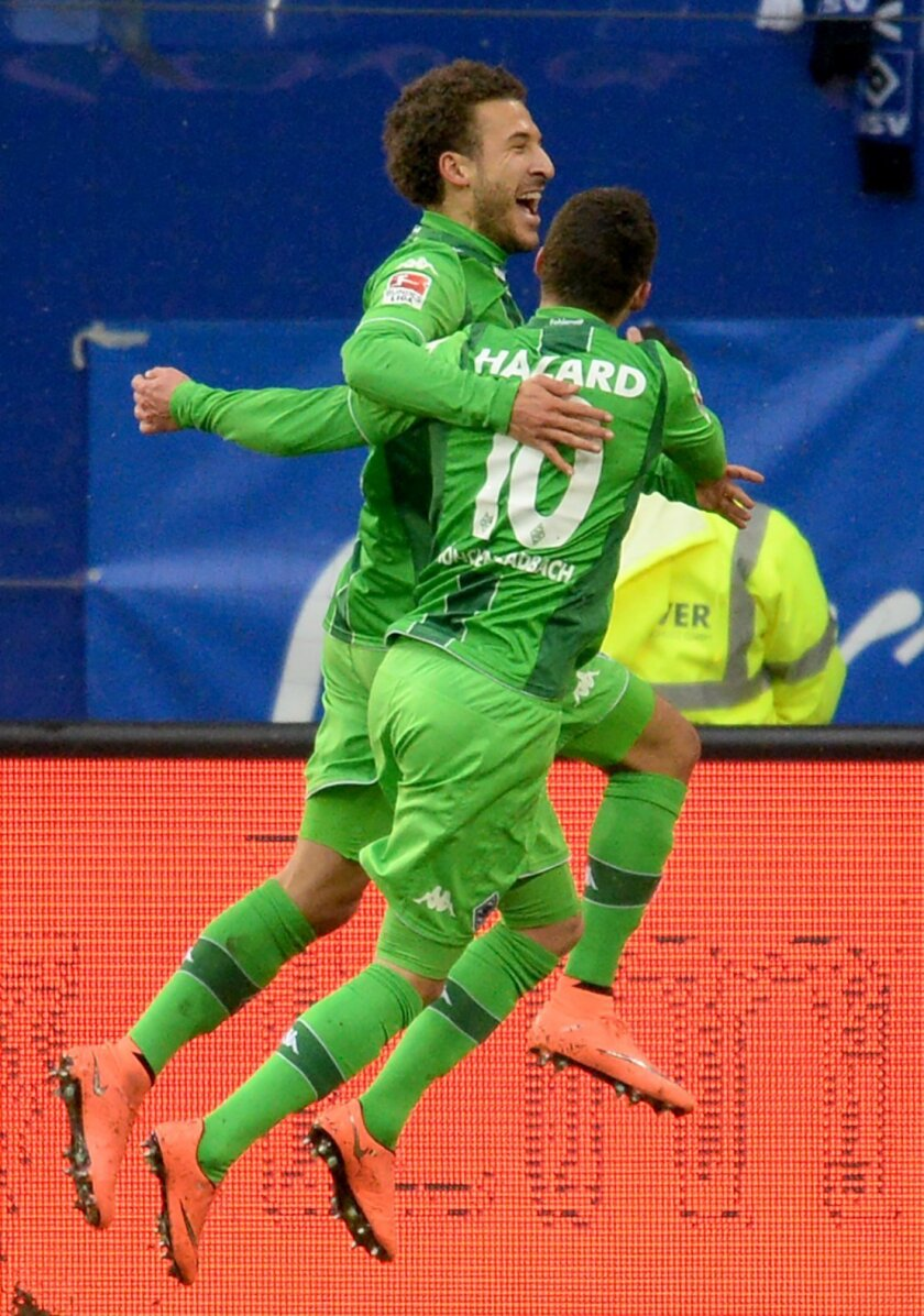 Moenchengladbach scorer Fabian Johnson , left, celebrates with teammate Thorgan Hazard during the German Bundesliga soccer  match between Hamburger SV and Borussia Moenchengladbach  in Hamburg, Germany,  Sunday Feb. 14, 2016. (Daniel Bockwoldt/dpa via AP)