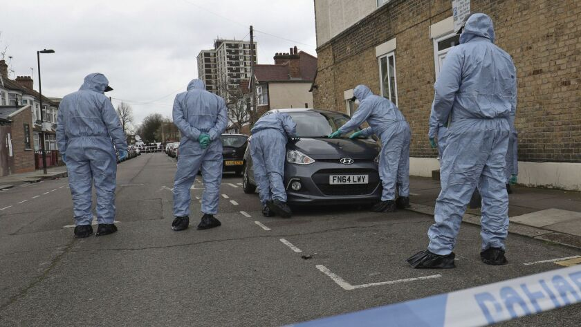 Forensic officers search the scene where a 17-year old girl was shot and died after on Monday evenin