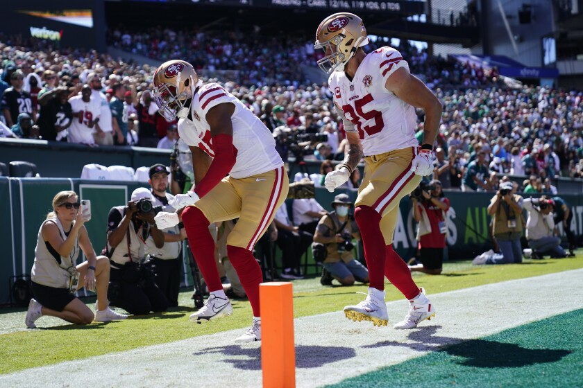 San Francisco 49ers wide receiver Jauan Jennings (15) celebrates a touchdown with teammate George Kittle (85) during the first half of an NFL football game against the Philadelphia Eagles on Sunday, Sept. 19, 2021, in Philadelphia. (AP Photo/Matt Rourke)