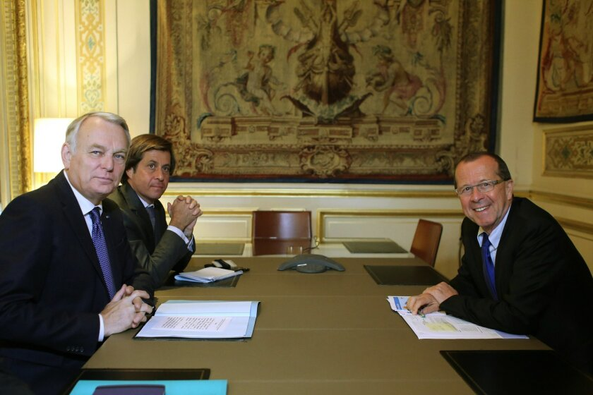 French Foreign Minister Jean Marc Ayrault, left, and U.N. envoy for Libya Martin Kobler pose prior to a meeting, at the Quai d'Orsay, in Paris, Tuesday, May 31, 2016. Kobler is in Paris to discuss international efforts to support the new Libyan government. (AP Photo/Thibault Camus)