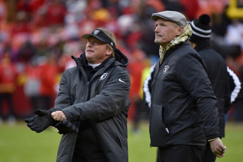 FILE - In this Dec. 1, 2019, file photo, Oakland Raiders general manager Mike Mayock stands with coach Jon Gruden before the team's NFL football game against the Kansas City Chiefs in Kansas City, Mo. Mayock's first rookie class as general manager of the Raiders was an extremely productive one. Whether this year's class can perform in similar fashion could help determine whether the Raiders can be a playoff contender in the AFC in their first season in Las Vegas. (AP Photo/Ed Zurga, File)