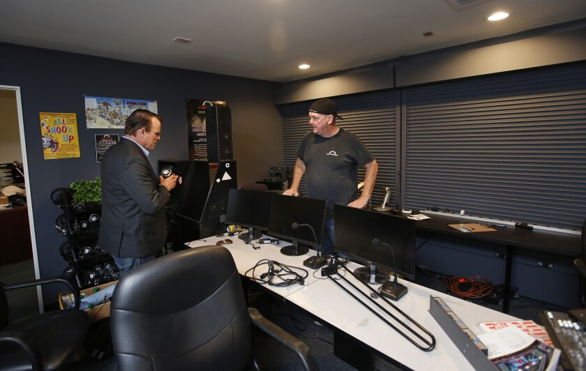 Chris Parks, left, and Steve Stopper of Save Starlight look over an audio and video mixing room at the Starlight Bowl amphitheater in Balboa Park, which was broken into last week. Thieves stole an estimated $50,000 worth of equipment and memorabilia, shown here Monday.