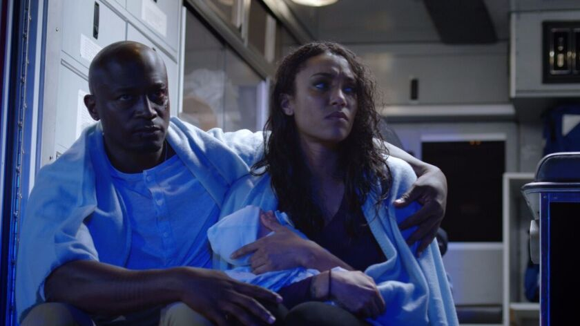 "Taye Diggs and Annie Ilonzeh in ""'Til Death Do Us Part."""