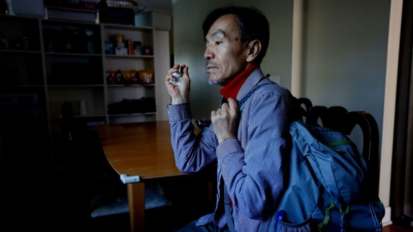 Seon Jin Kim, 62, is among the more than a dozen people living in an unofficial homeless shelter that the Rev. John Kim of St. James Episcopal Church has been running since 2009.