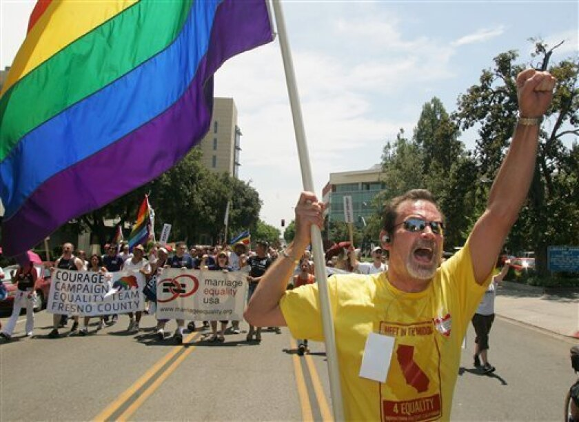 Chip Garcia Coakley leads marchers walking to a Meet in the Middle 4 Equality rally in Fresno, Calif. on Saturday, May 30, 2009 to protest the California Supreme Court decision to uphold Proposition 8 which bans gay marriage in the state Constitution. (AP Photo/Gary Kazanjian)