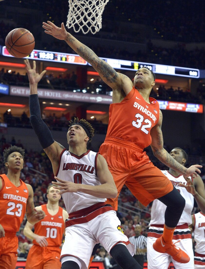Louisville's Damion Lee (0) attempts a shot around the defense of Syracuse's DaJuan Coleman (32) during the second half of an NCAA college basketball game, Wednesday, Feb. 17, 2016, in Louisville Ky. Louisville won 72-58. (AP Photo/Timothy D. Easley)