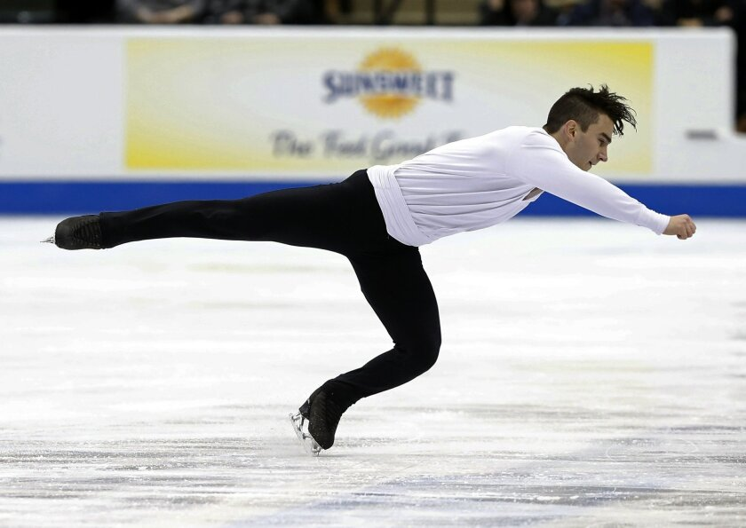 Max Aaron performs in the men's short program of the U.S. Figure Skating Championships, Friday, Jan. 22, 2016, in St. Paul, Minn. Aaron finished in first place. (AP Photo/Jim Mone)
