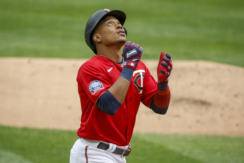 Minnesota Twins' Jorge Polanco celebrates his solo home run against the Detroit Tigers in the first inning of the first game of a baseball doubleheader Friday, Sept. 4, 2020, in Minneapolis. (AP Photo/Bruce Kluckhohn)