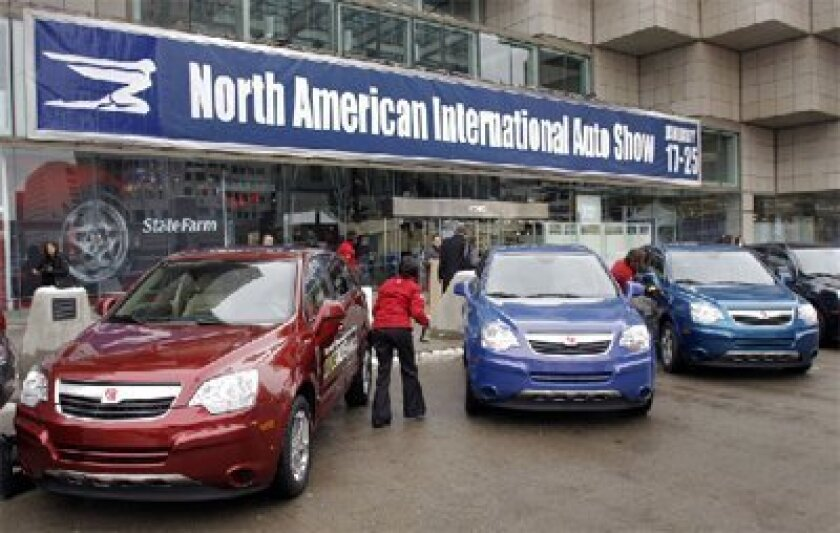 Hybrid vehicles from General Motors were on display yesterday at the North American International Auto Show in Detroit, where GM announced that it plans to team up with LG Chem Ltd. of South Korea to assemble lithium-ion batteries. (Bill Pugliano / Getty Images)