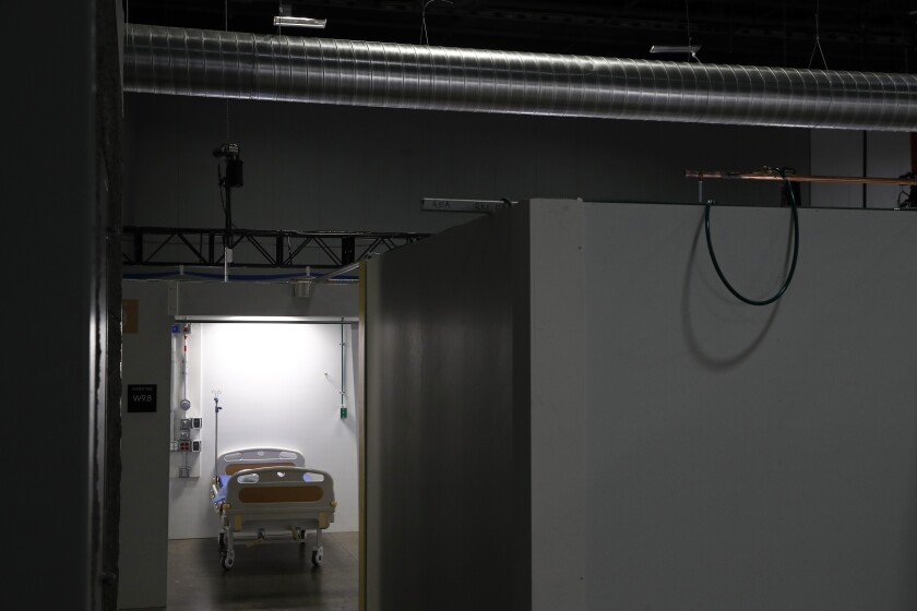 FILE - In this May 11, 2020, file photo light shines in a patient pod at a temporary alternate care site constructed in response to the coronavirus outbreak inside the Walter E. Washington Convention Center in Washington. People are still more likely to prefer the private sector than the government on driving innovation in health care, improving quality and, by a narrower margin, providing coverage, according to the survey by the University of Chicago Harris School of Public Policy and The Associated Press-NORC Center for Public Affairs Research. (AP Photo/Patrick Semansky, FIle)