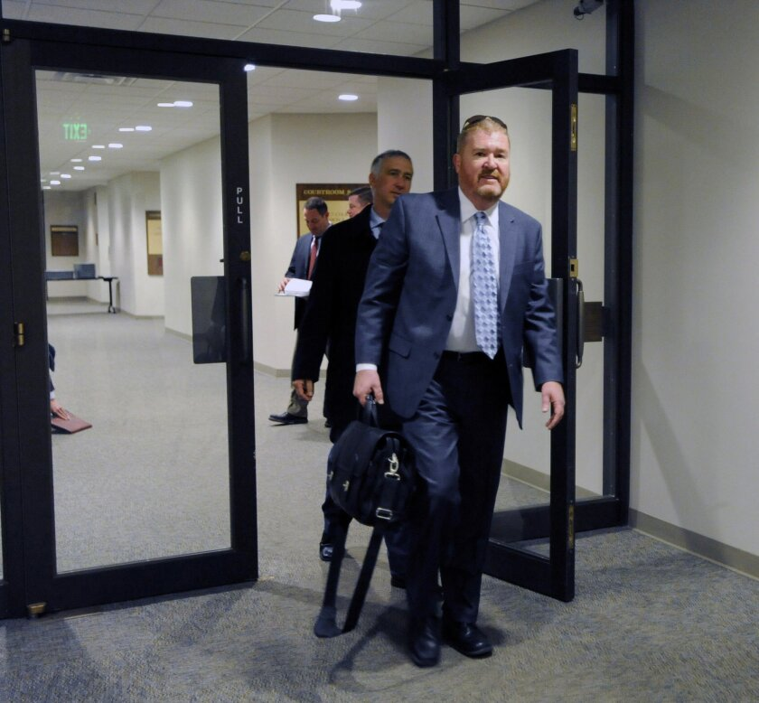 Defense attorney Dan King leaves the courtroom after a court appearance by admitted Planned Parenthood shooter Robert Dear on Thursday, March 24, 2016 at the El Paso County Courthouse in Colorado Springs, Colo. (Jerilee Bennett/The Gazette via AP)