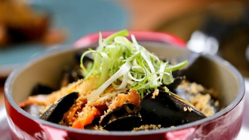The wood-fired mussels with smoked tomato and beer broth at Fireside. (Courtesy photo)