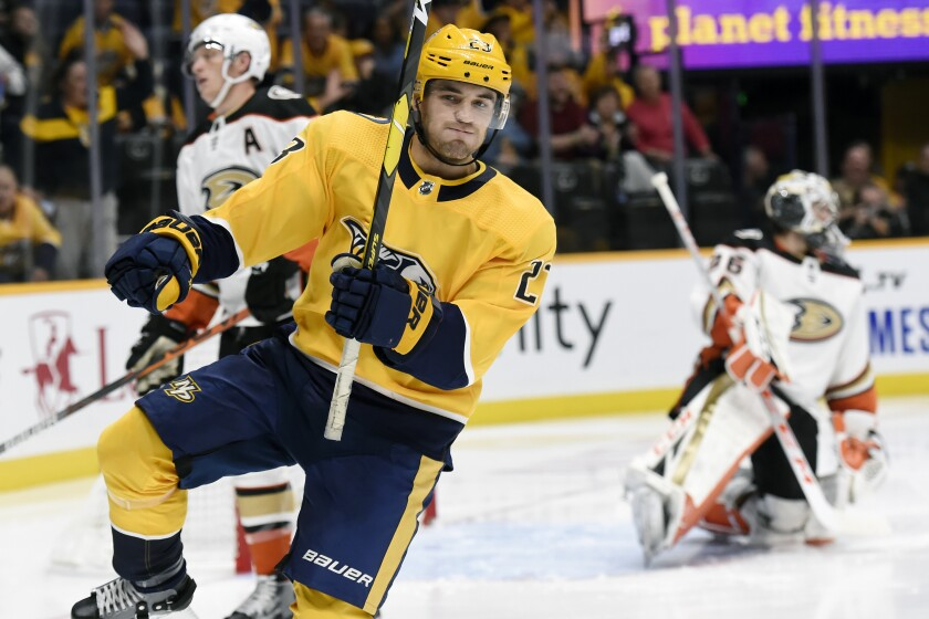 Nashville Predators center Rocco Grimaldi (23) celebrates his goal against the Ducks during the second period om Tuesday in Nashville, Tenn.