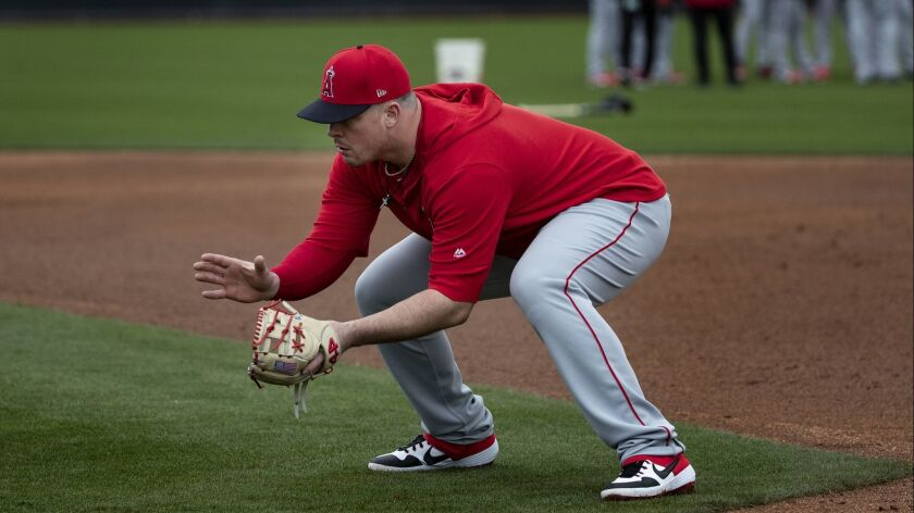 Angels first baseman Justin Bour takes grounders during spring training at Tempe Diablo Stadium on Feb. 18 in Tempe, Ariz.