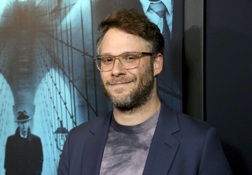 """FILE - Seth Rogen appears at the """"Motherless Brooklyn"""" premiere in Los Angeles on Oct. 28, 2019. Rogen is the latest to jump into the podcast world. He's making a series for the Stitcher podcast company where he interviews people with unusual stories to tell. (Photo by Willy Sanjuan/Invision/AP, File)"""