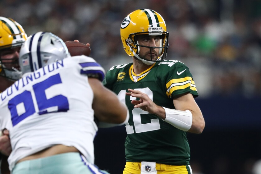 Green Bay Packers quarterback Aaron Rodgers looks to pass against the Dallas Cowboys.
