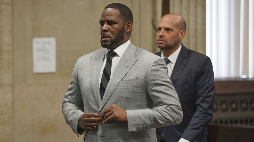 FILE - In this June 6, 2019, file photo, singer R. Kelly appears in court in Chicago. Chicago police say two girlfriends of R. Kelly fought Wednesday, Jan. 8, 2020, inside the embattled singer's Trump Tower condominium, resulting in one of the women being taken to a nearby hospital. (E. Jason Wambsgans/Chicago Tribune via AP, Pool, File)