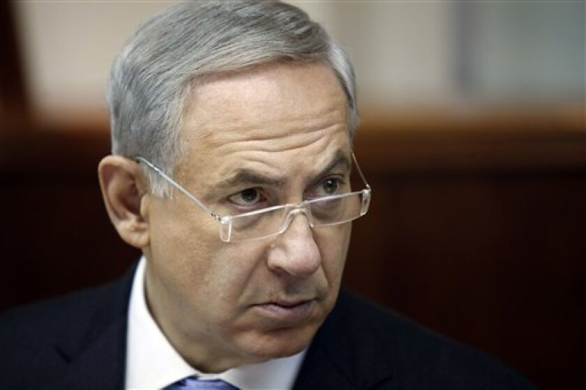 Israeli Prime Minister Benjamin Netanyahu listens during the weekly cabinet meeting in Jerusalem, Sunday, Aug. 4, 2013. Palestinian negotiator Saeb Erakat says that Israel will free the first batch of a promised 104 long-serving Palestinian and Israeli Arab prisoners on Aug. 13. (AP Photo/Gali Tibbon, Pool)