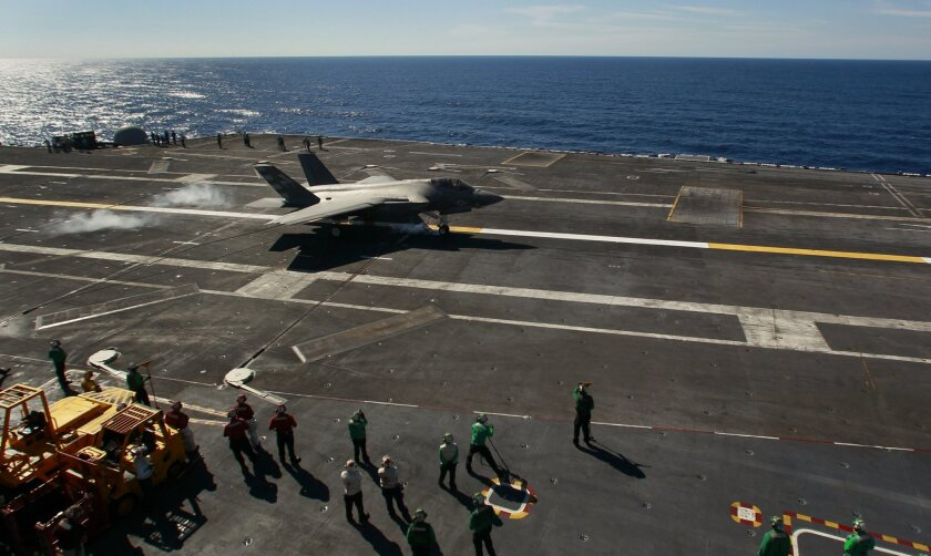 """History was made off the coast of San Diego on Monday November 3, 2014 as the Navy's newest plane, the F-35C Joint Strike Fighter, made the first ever landing on an aircraft carrier, in this case, the USS Nimitz. Navy Cmdr. Tony """"Brick"""" Wilson was the Navy Test Pilot who made the landing."""