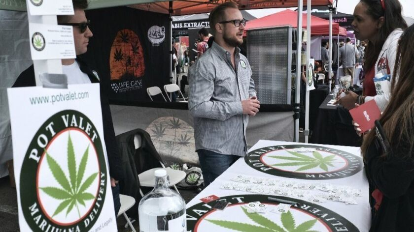 This March 31, 2018 photo shows a booth advertising a delivery service for cannabis at the Four Twen
